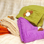 Colorful soft blankets part of bedroom decor