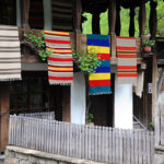 Traditional Bulgarian woven fabrics on the balcony of the wooden house in Etar village