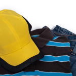 yellow cap, polo shirt and blue jeans
