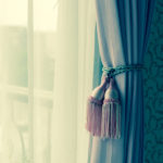 Curtain with curtain tieback at window. Processed with vintage style.